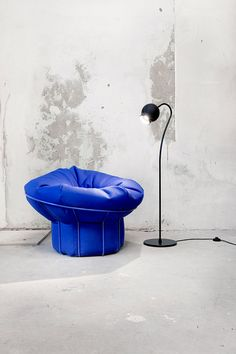 Unique furniture- this chair (in stunning blue) is a beanbag chair with a metal frame that help it keep its form.
