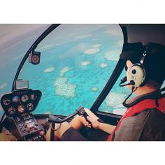 24 hours @Hayman Great Barrier Reef | 1pm: Be the co-pilot on a magic helicopter ride over the world's largest reef. #greatbarrierreef #whitsundays #helicopter #view