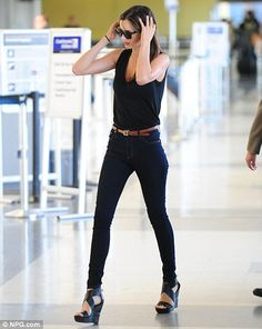 high waisted jeans and black shirt... my kind of girl.
