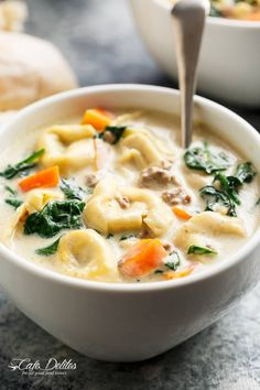 Slow Cooker Creamy Tortellini Soup is pure comfort food, loaded with vegetables, Italian sausage and cheese tortellini! NO flour and NO heavy cream!