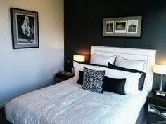 Black and white room with black and white pin striping wall paper. Vogue