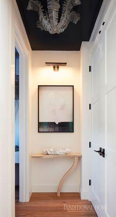 "Overhead, the ceiling painted Pratt and Lambert's ""Witching Hour"" amplifies the drama of this narrow hallway. - Photo: John Merkl / Design: Kimberley Harrison"
