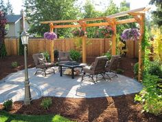 walkways, Patios, & Driveways Interlocking concrete pavers Landscape contractor Landscapers Landscaper Fircrest Washington Fire pit paver patio in gig harbor pierce county washington Old dominion patio with steps to upper yard Classic brick walkway parkla