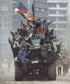 Romanian Revolution 1989 Protesters rejoice after taking control of a military vehicle in Bucharest. Bulgaria, Romanian Revolution, Military Photos, Political Events, Historical Images, Interesting History, World History, European History, Cold War