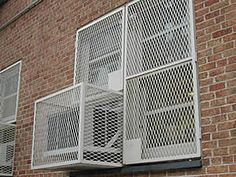 A set of window guards are installed outside the windows and one air conditioner.