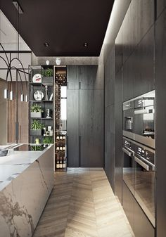 Extraordinary Kitchen Remodeling Planning and Ideas Luxury Kitchens Luxurious modern apartment / KITCHEN. White marble block kitchen island with dark wood cabinetry and thin tall wine display and storage. Love the shelves with storage space too Modern Kitchen Interiors, Luxury Kitchen Design, Best Kitchen Designs, Luxury Kitchens, Interior Design Kitchen, Kitchen Modern, Modern Kitchens With Islands, Contempory Kitchen, Contemporary Kitchen Island
