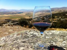 The flavours of this glass of Central Otago Pinot Noir is inextricably linked to this magnificant landscape in which it is grown.