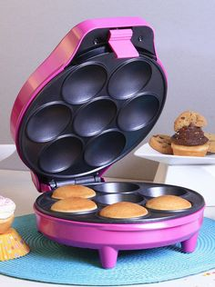 Magenta Cupcake Maker. i have never heard of a cupcake maker before but i really think i could use this. like insta cupcakes all the time.
