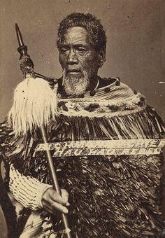 Maori chief holding a taiaha.