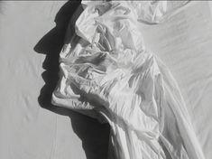 L'homme dans les draps, Vidéo noir et blanc …  2003 … by Alain Fleischer…