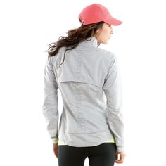 Sprint Jacket by Moving Comfort. A jacket so cute it would be a shame if you only wore it for running.  Lightweight, water and wind resistant, reflective trim at bottom seam, entire jacket packs into it's left pocket when not in use.