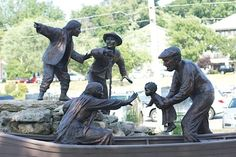 Freedom Crossing Monument is located on the bank of the Niagara River in Lewiston, New York, and honors the courage of fugitive slaves who sought a new life of freedom in Canada, and to the local volunteers who helped them on their journey across the Niagara River. The statue based on a fictional book, Freedom Crossing, is breathtaking, because a character from the book, Laura, is disguised in men's clothing and pointing  to Canada, while a real life hero is helping a family onto a boat.