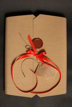 Original brand package, a cardboard box with a wax seal, decorated with satin ribbons. - 7$