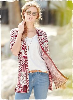 A Laotian totem motif from an early 20th century textile gives this easy cardigan its visual impact. Jacquard knit in madder and ivory pima,...