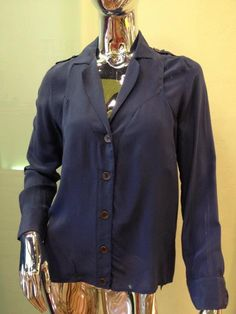 Blue Paneled Blouse.  Pair with a black pencil skirt for an uber chic look!