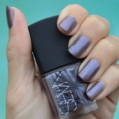 purple-glitter-nails-different-color-nails-hand-holding-a-purple-nail-polish-bottle Red Glitter Nail Polish, Nars Nail Polish, Black Nails With Glitter, Pretty Nail Colors, Fall Nail Colors, Natural Gel Nails, Different Color Nails, Black Nail Designs, New Nail Art
