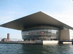 Copenhagen Opera House, Denmark. Henning Larsen. This building reminds me off a small rubber ball being squished by a hand. The roof extends far beyond the edge of the building and creates a nice outside space for people passing by.