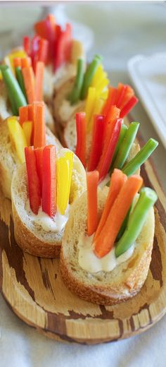Veggies and dip in a baguette cup. It's a very neat idea instead of having a platter out.