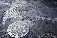 Urban Photography Theme: City Details - Man hole cover NYC