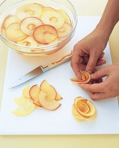 Apple Roses ~ apple slices softened in a warm sugar syrup.  From Martha Stewart.