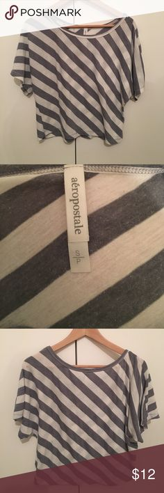Grey and white striped Aeropostale shirt. This Grey and white striped Aeropostale shirt is super cute and can be worn of the shoulder. It's lightweight and in great condition! Aeropostale Tops Tees - Short Sleeve