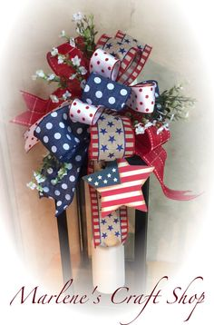 Patriotic Lantern Swag, Patriotic Bow, Fourth of July Lantern Swag, Summer Decoration. Red White and Blue Lantern Decoration. Memorial Day Decoration. Red white and Blue Ribbon. Get ready for the Summer months with this Patriotic Lantern Swag. The swag is pictured on a 22 in Lantern (Lantern not included in price) and features FOUR different bows coordinating with the handcrafted wooden star ornament attached to the design. There are white little flowers embellishing the swag as well…