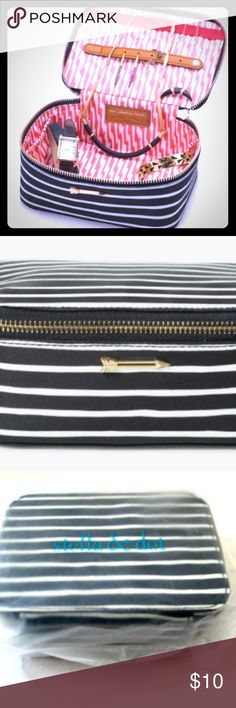 Stella & Dot Striped Jewelry Makeup Case Stella & DotTravel Jewelry BoxBlack Cream Stripe Organizer - New With Tags Could easily be used as a makeup case!   This is a 100% Genuine Stella & Dot Product! Product is new and will come in original packaging.  Exterior: Woven wipeable fabric  Hardware: Shiny gold signature Stella & Dot arrow detail hardware.  Interior: Coral and white ikat  Jewelry not included.  : ) Stella & Dot Other