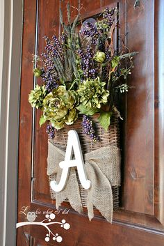 front door welcome flowers. my mom has 2 baskets like that and we could easily find a wooden letter and attach it