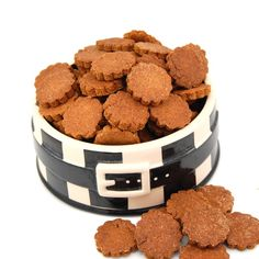 Peanut Butter Dog Biscuits    Ingredients:        3/4 cup nonfat Milk      1 egg      1 cup Peanut Butter, smooth      2 1/4 to 2 1/2 cups Whole Wheat Flour      1 tablespoon Baking Powder      1/8 teaspoon ground cinnamon