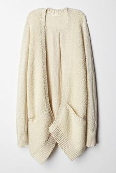 Cocoon cardigans are perfect for Fall layering, like this cream boucle cardigan.