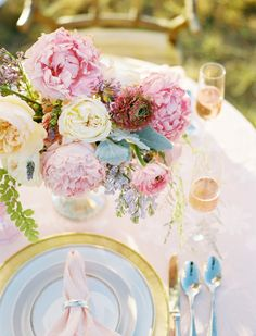 gold and pink inspired tablescape with pastel floral arrangement #tabledecor #weddingreception #weddingchicks http://www.weddingchicks.com/2014/02/14/dinner-for-two-wedding-ideas/