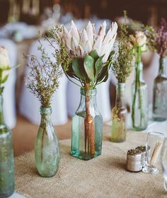 A simple idea for an eco wedding - recycled glass bottles as stem vases
