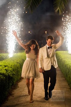 Sparklers are always dramatic and festive | @christianoth | Brides.com