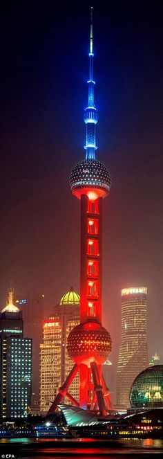 Shanghai's landmark Oriental Pearl Tower lit in the French national colours as a mark of respect to the victims of the terrorist attacks in Paris on 13 November 2015.