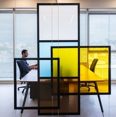 "The tangible selection mix of concrete, wood and colored acrylic creates a space that integrates the sobriety of cyber enforcement and quintessential dynamism and FUN of an aspiring Hi-Tech company. Choosing relatively simple materials, dismissing extravagant ""decor"", was not only a budgetary constraint, but also an ideological one, reflecting the company's spirit."