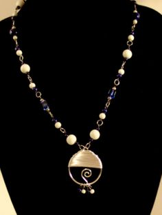 Wire-Wrapped Silver, Blue, and White Beaded necklace. Made-to-order requests available!
