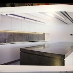 White kitchen with concrete bench top