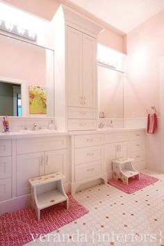 Childrens Bathrooms - linen between sinks. Great Idea to separate the two kids so there is no argument.