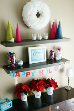 Love the yarn wrapped trees and the vases with christmas bulbs in them