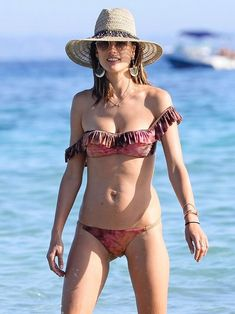 Alessandra Ambrosio knows ruffles look great on vacation   Sexy Swimwear Styles to give you a Stunning Silhouette