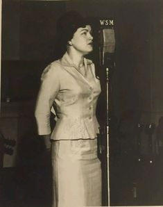 Patsy Cline early 1960's performing  on a WSM early morning show and not seen in this photo is that she also was performing before a touring group of seniors visiting the  Studios..
