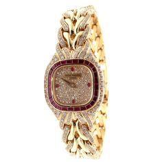 Patek Philippe Lady's Yellow Gold, Diamond and Ruby La Flamme Bracelet Watch. Circa 1991s
