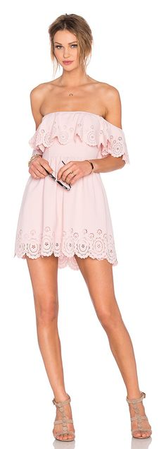 X revolve dream vacay dress by Lovers + Friends. 95% poly 5% spandex. Hand wash cold. Fully lined. Elastic neckline. Ruffle accent. Laser cut-out ...