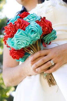 Alternative Wedding Bouquets These bright roses are actually made using thick rolls of ribbon pperfect for a casual wedding