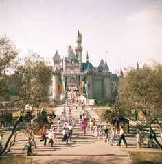 Guests running towards Sleeping Beauty Castle. | 18 Wonderful And Rare Color Photos Of Disneyland In 1955