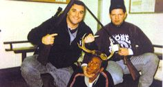 Former Chicago police officers Jerome Finnigan and Timothy McDermott pose with an unidentified suspect (Chicago Sun-Times from a court filing)