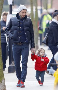 Harper is so sassy in London. Get more cute pictures of her with dad David Beckham!
