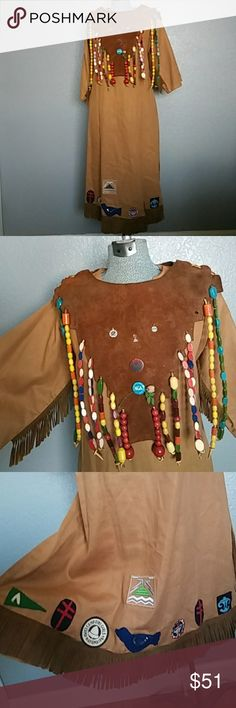 """'64 Camp Fire Girls Ceremonial Gown 1964 Camp fire girls ceremonial gow. Hand made by campfire girls. Suede fringe and matching suede collar that was decorated with the many beads earned for each of accomplishment. Each of the large beads represent 10 smaller beads that were traded in for a large. Also adorned with several pins and patches.This garment was made to be worn loose. Bust about 21.5"""" Waist about 23"""" from shoulder to hem about 44"""" Beautiful condition. One leather patche in back is…"""