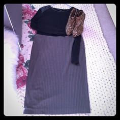 Gray/white Striped Limited Pencil Skirt Gray Limited pencil skirt with slim white lines throughout; 26 inch length with invisible back zipper and hook and eye closure. Back slit as seen in pictures 3 and 4. Polyester/rayon/spandex blend. Great buy for work wear! The Limited Skirts Pencil