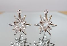 Celebrate #jewelryjune with these NEW Stellar Drop Earrings in Rhodium Plated Brass.    These earrings take the shape of a three-dimensional star and are solely made up of knight's moves on a three-dimensional 3x3x3 chessboard.  The captivating star shape catches everyone's eyes.  #starbright #starearrings #star #stellar #rhodiumplated #dropearrings #3dprintedjewelry  #nycstyle #nyclife #nycjewelry #nycfashion #shiny #mathjewelry #mathart #chess #geometricearrings #uniquejewelry…